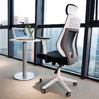 an image of a stylish ergonomic office chair in a home office setup