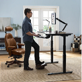 An employee working on an elevated desk