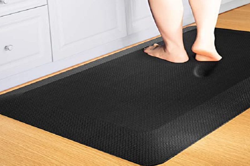 a person stepping on the anti-fatigue mat