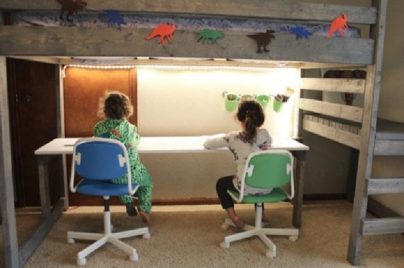Children studying in a loft bed with a desk