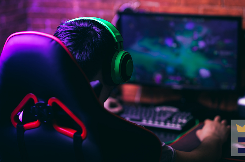 A person playing on an ergonomic chair gaming