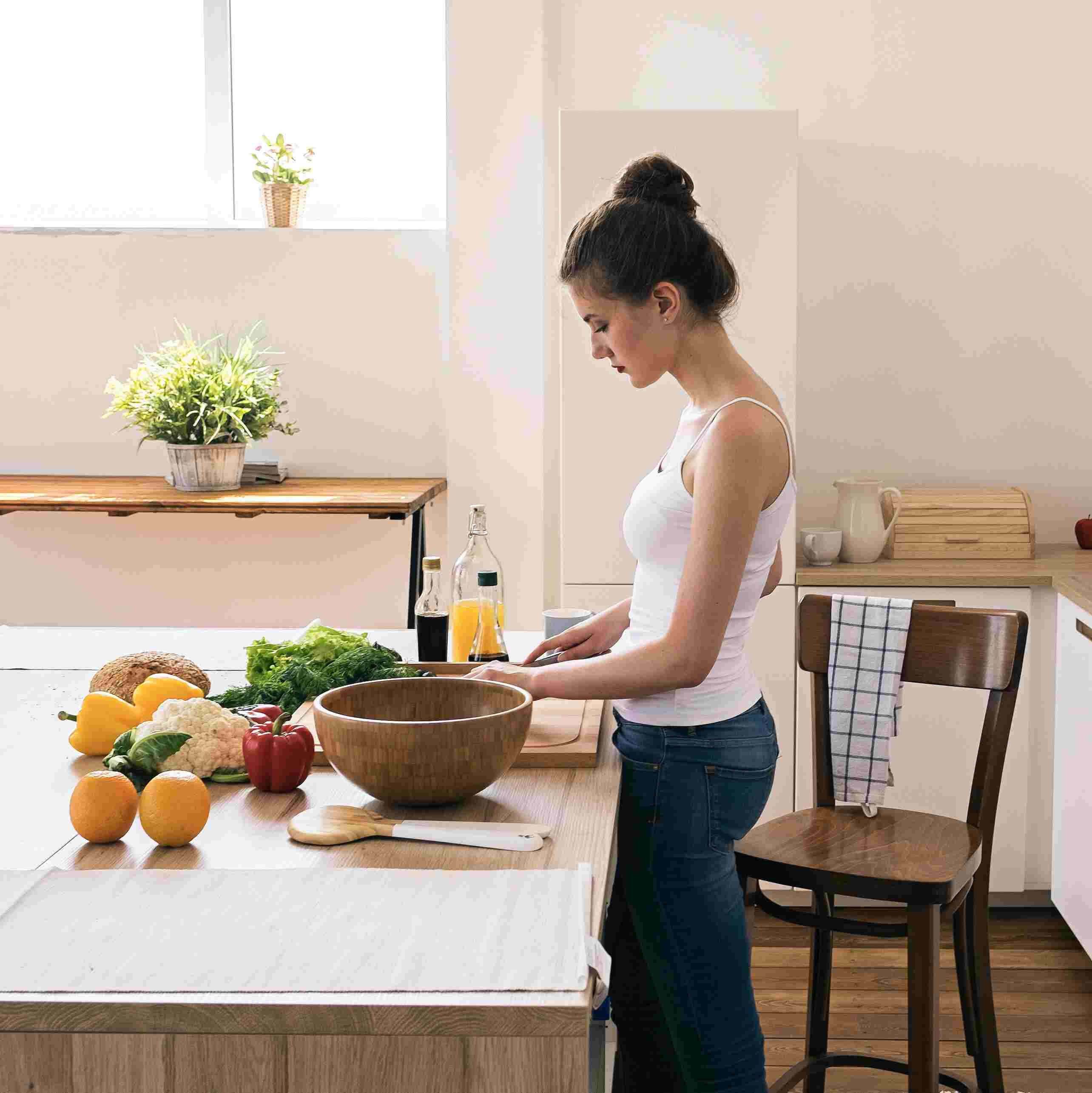 A girl is cutting fruit