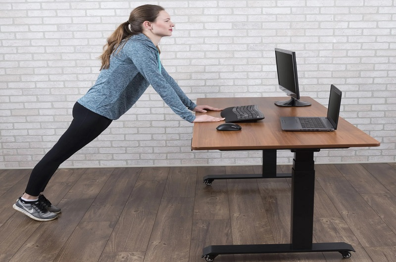 The desk that serves as a workout buddy.