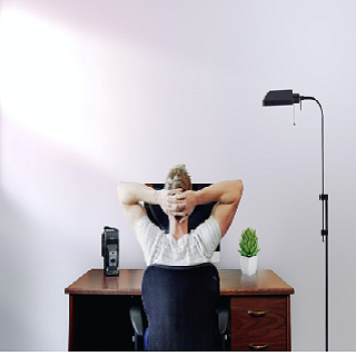 A man sitting at his home office desk