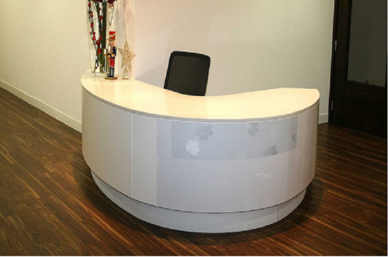 A curved desk at a reception