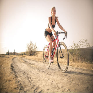 woman cycling outdoors