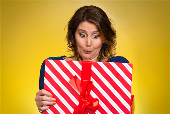 a female employee is checking her gift from her boss