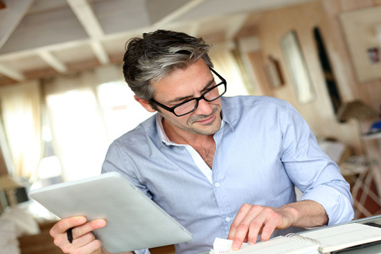 Handsome businessman with glasses working from home
