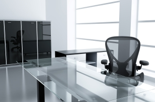 The Glass Top of an Office Desk