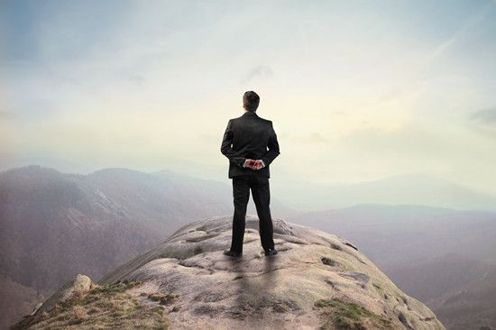 A leader is standing on the mountain top