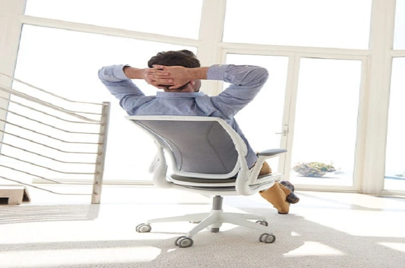 a man relaxing on the chair
