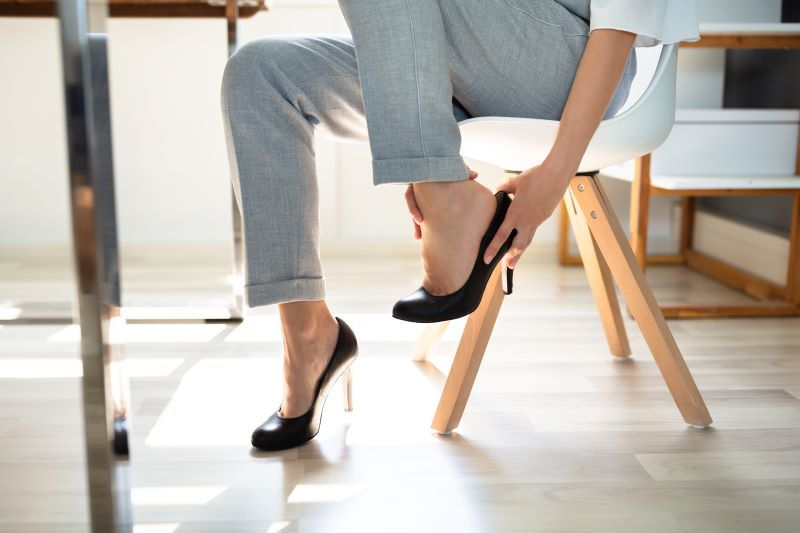 woman touching her foot