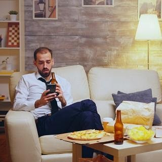 man chilling on couch