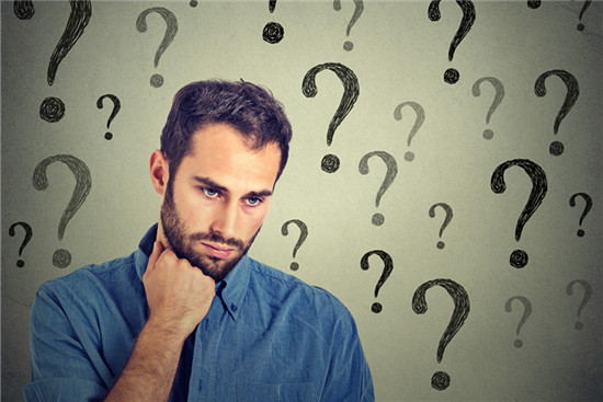 Worried sad man has many questions looking down