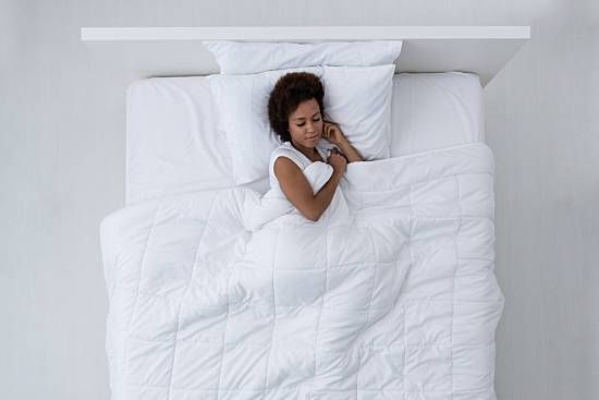 Using a gravity blanket may minimize anxiety, help you fall asleep faster and sl