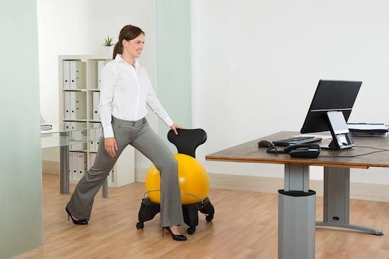Woman doing a leaning stretch in her office.
