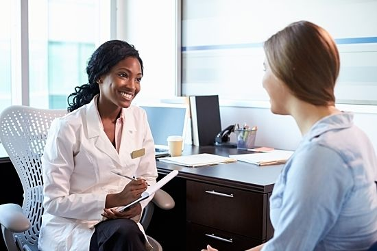Female doctor speaking with patient