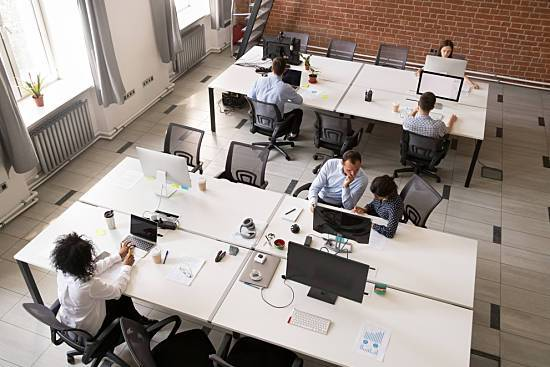 Employees working in an open office.
