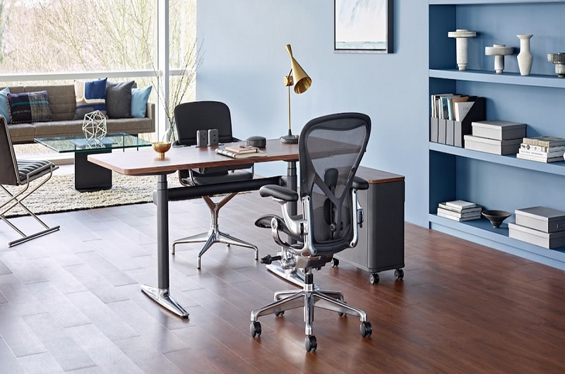 A home office setup with ergonomic chairs