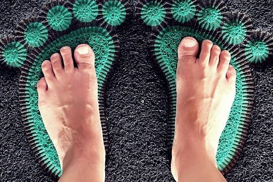 Standing on a Foot Mat