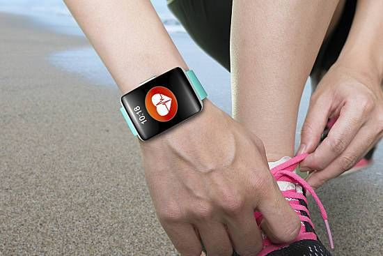 Woman tying her shoe, fitbit around her wrist
