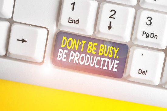 A keyboard shows Don't be busy, be productive