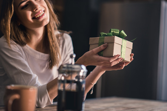 A woman is showing her gift for holiday season