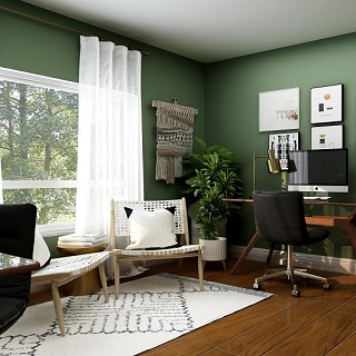 Office space with wooden floors and plain green walls
