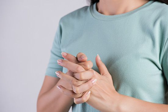 Woman Cracking Her Knuckles