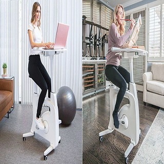 Exercising with laptop stand desk stationary bike