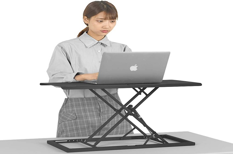An Ergonomic Laptop Stand Desk in use