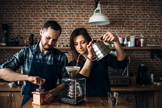 Man and woman making coffee