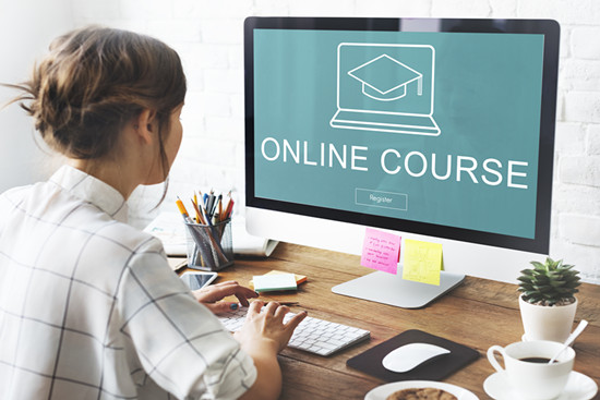 A home office worker is creating her online course