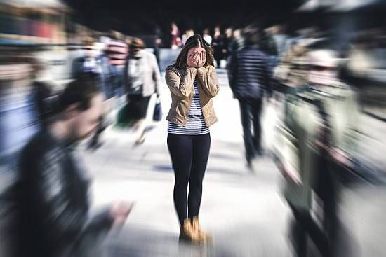 A woman has a panic attack in public