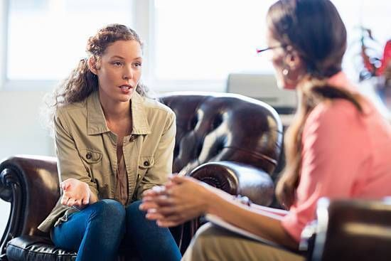 Young woman meeting with a therapist