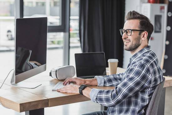 a happy office man sitting at desk
