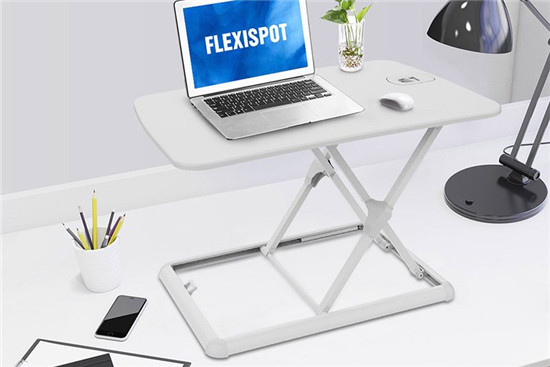 A standing desk converter helps you do that without losing work time