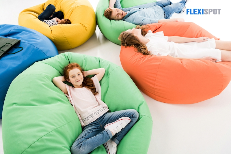 family resting on beanbag chairs