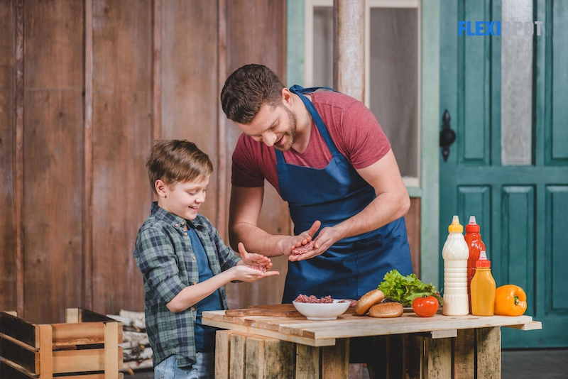 Father and son cooking burgers