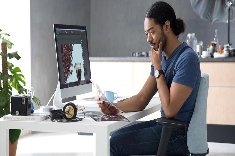 Employee sitting on a white desk chair