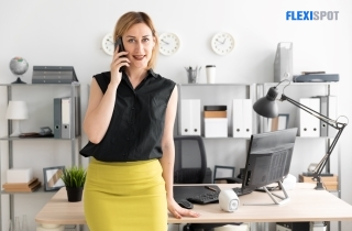 woman standing with her desk