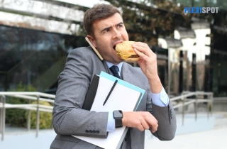 man in a hurry to work while eating