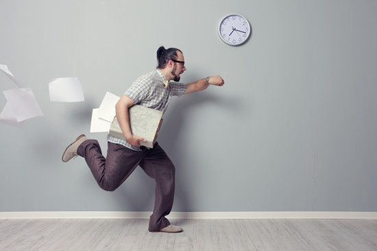An office staff is hurrying to finish his work