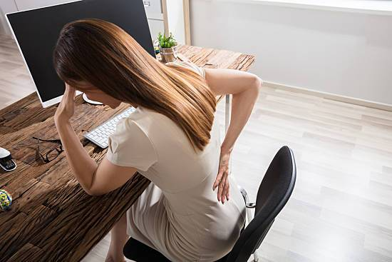 Sitting too long can cause back pain